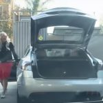 Blonde Woman Trying To Fill Up Petrol In Electronic Tesla Car